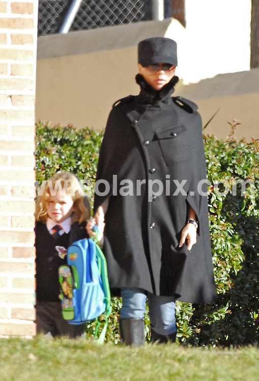 **ALL ROUND PICTURES FROM SOLARPIX.COM**.**WORLDWIDE SYNDICATION RIGHTS EXCLUDING SPAIN - NO PUBLICATION IN SPAIN**.Victoria Beckham today in Madrid with Brooklyn and Romeo. She was wearing an outfit which closely resembled that worn Captain Scarlet in the 1970s..JOB REF: 3223 RAP  12/01/07.**MUST CREDIT SOLARPIX.COM OR DOUBLE FEE WILL BE CHARGED**