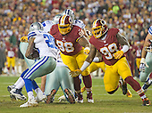 Washington Redskins defensive tackle Terrance Knighton (98) and defensive tackle Ricky Jean Francois (99) pursue Dallas Cowboys running back Darren McFadden (20) in early first quarter action at FedEx Field in Landover, Maryland on Monday, December 7, 2015. The Cowboys won the game 19-16.<br /> Credit: Ron Sachs / CNP