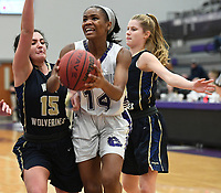 NWA Democrat-Gazette/J.T. WAMPLER Fayetteville's Coriah Beck takes the ball to the lane between Bentonville West's Anna Kash (15) and Kadie Kultgen Wednesday Feb. 7, 2018 at Bulldog Arena in Fayetteville. The Lady Bulldogs won 64-46.