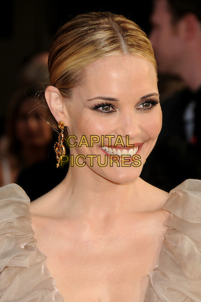 "LESLIE BIBB .""Iron Man 2"" World Premiere held at the El Capitan Theatre, Hollywood, California , USA, .26th April 2010..arrivals portrait headshot hair up smiling  gold earrings dangly  beige sleeveless  smiling  .CAP/ADM/BP.©Byron Purvis/AdMedia/Capital Pictures."