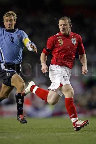 1 March 2006: England striker Wayne Rooney full-length during the International friendly match between England and Uruguay played at Anfield, Liverpool. England won the game 2-1 Photo: Glyn Kirk/Actionplus...060301 football soccer player