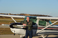 Mike Love, flight instructor who teaches aerobatics, poses with his training plane at Morey Airplane Co. at Middleton Municipal Airport on Thursday, 10/21/10