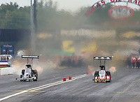 Aug 30, 2014; Clermont, IN, USA; NHRA top fuel dragster driver Doug Kalitta (right) races alongside Brittany Force in the Traxxas Shootout during qualifying for the US Nationals at Lucas Oil Raceway. Mandatory Credit: Mark J. Rebilas-USA TODAY Sports