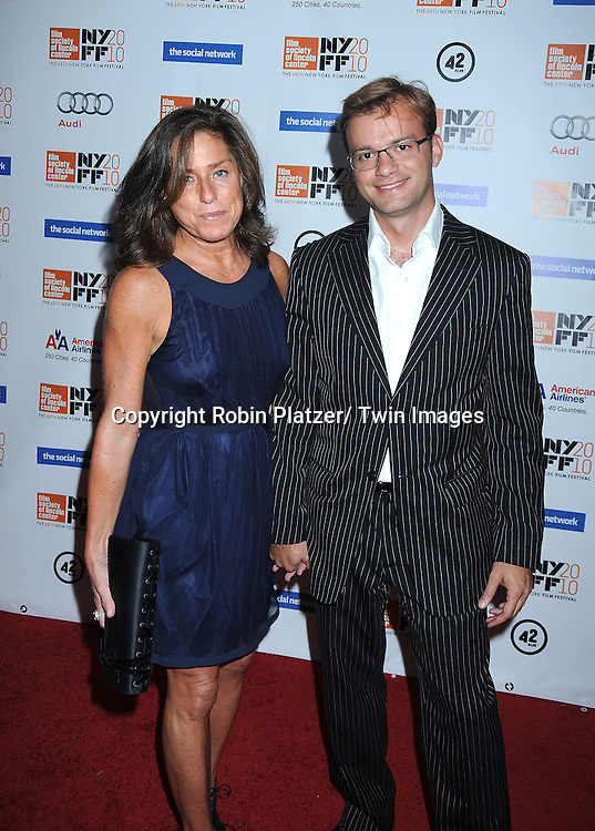 "Liz Swig and Georges Aramos  posing for photographers at the Opening Night of The New York Film Festival world premiere of ""The Social Network"" on September24, 2010 at Alice Tully Hall in New York City."