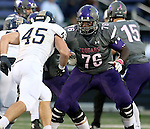 SIOUX FALLS, SD - OCTOBER 4: Antonio Oliver #76 from the University of Sioux Falls looks to the defense of Nick Jauch #45 from Concordia St. Paul in the first half of their game Saturday evening at Bob Young Field.(Photo by Dave Eggen/Inertia)