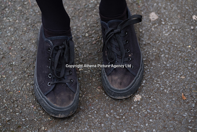 """COPY BY TOM BEDFORD<br /> Pictured: Shoes worn by a pupil at Ysgol Penglais School in Aberystwyth, Wales, UK<br /> Re: More than 400 pupils at a comprehensive school in Aberystwyth were given detention on their first day back for breaking school uniform rules.<br /> The uniform was changed at Ysgol Penglais over the summer, following a consultation.<br /> But a number of parents have complained to the school and some 250 have signed a petition saying the punished pupils were """"treated unfairly"""".<br /> Ceredigion council said a large number of pupils were kept in at break times.<br /> The new uniform was brought in for the start of the new academic year, with the old navy blue pullover and white polo shirt replaced by a grey v-neck jumper, white shirt and a tie. Sixth formers have a similar outfit.<br /> It is compulsory for all pupils in years 7 and 12 to wear the new uniform, with other students being given the rest of the year to buy it.<br /> This was outlined in correspondence sent to all parents over the summer months, which also stipulated what trousers, skirts and shoes would be deemed acceptable.<br /> But the petition said the new rules were not clear enough and that the pupils should not have been punished for their parents' mistakes.<br /> It also said a warning should have been given before the detention."""