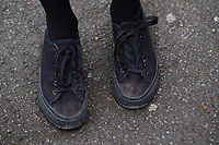 COPY BY TOM BEDFORD<br /> Pictured: Shoes worn by a pupil at Ysgol Penglais School in Aberystwyth, Wales, UK<br /> Re: More than 400 pupils at a comprehensive school in Aberystwyth were given detention on their first day back for breaking school uniform rules.<br /> The uniform was changed at Ysgol Penglais over the summer, following a consultation.<br /> But a number of parents have complained to the school and some 250 have signed a petition saying the punished pupils were &quot;treated unfairly&quot;.<br /> Ceredigion council said a large number of pupils were kept in at break times.<br /> The new uniform was brought in for the start of the new academic year, with the old navy blue pullover and white polo shirt replaced by a grey v-neck jumper, white shirt and a tie. Sixth formers have a similar outfit.<br /> It is compulsory for all pupils in years 7 and 12 to wear the new uniform, with other students being given the rest of the year to buy it.<br /> This was outlined in correspondence sent to all parents over the summer months, which also stipulated what trousers, skirts and shoes would be deemed acceptable.<br /> But the petition said the new rules were not clear enough and that the pupils should not have been punished for their parents' mistakes.<br /> It also said a warning should have been given before the detention.