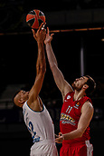 9th February 2018, Wiznik Centre, Madrid, Spain; Euroleague Basketball, Real Madrid versus Olympiacos Piraeus; Walter Tavares (Real Madrid Baloncesto) jumps off at the start of the match with Nikola Milutinov (OLYMPIACOS BC)