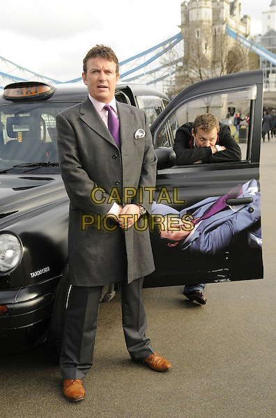 "SHANE RICHIE & LEX SHRAPNEL  .The ""Minder"" 80's sitcom remake photocall, Potters Field, London, England..January 13th, 2009.full brown brown shoes length grey gray coat jacket purple jacket top tie cab taxi car leaning arms crossed .CAP/CAN.©Can Nguyen/Capital Pictures."