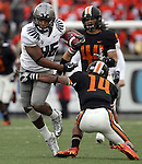 12/04/10-- Oregon's Michael Clay breaks through the arms of Oregon State's Jordan Poyer during a 63-yards on a fake punt in the third quarter of the Civil War game at Reser Stadium in Corvallis, Or..Photo by Jaime Valdez