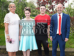 Abbie Reid who was Confirmed in the Holy Family Church Ballsgrove pictured with her mam Denise, dad Mark and brother Ethan. Photo:Colin Bell/pressphotos.ie