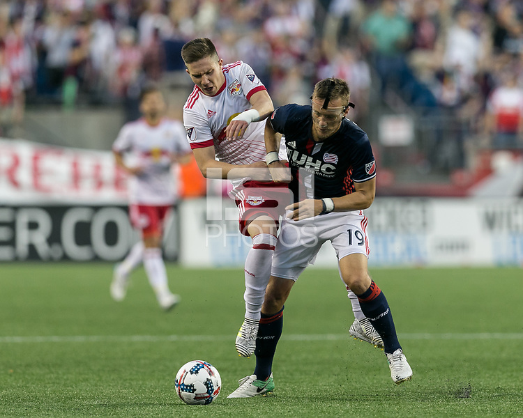 Foxborough, Massachusetts - July 5, 2017: First half action. In a Major League Soccer (MLS) match, New England Revolution (blue/white) vs New York Red Bulls (white), at Gillette Stadium.