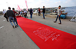 "Palestinians place a red carpet during the 3rd Annual Red Carpet Festival for Human Rights Films at the Gaza seaport, on May 12, 2017. The Red Carpet Festival is held in the Gaza Strip this year for the third year in a raw, amid international and Arab attention. This year, the Hash-Tag of the festival will be ""Let's go back"", which coincides with one hundred years for The Balfour Declaration, where the text of the Balfour Declaration is printed on the carpet. Photo by Mohammed Asad"