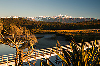 Sunset over Southern Alps with Mt. Tasman and Mt. Cook with Three Mile Lagoon and bridge, Westland National Park, West Coast, UNESCO World Heritage Area, New Zealand, NZ