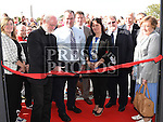 Fr Murtagh cuts the ribbon at the official opening of St. Kevin's Community Centre in Phillipstown. Photo:Colin Bell/pressphotos.ie