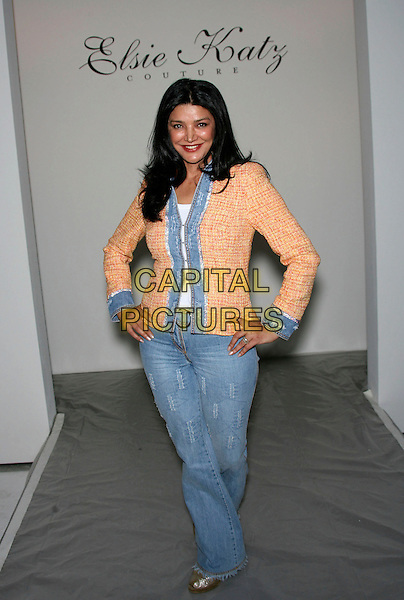 SHOHREH AGHASHLOO.Mercedes-Benz Fall 2006 L.A. Fashion Week held at Smashbox Studios, Culver City, California, USA..March 20th, 2006.Photo: Zach Lipp/AdMedia/Capital Pictures.Ref: ZL/ADM.full length jeans denim pink peach jacket hands on hips.www.capitalpictures.com.sales@capitalpictures.com.© Capital Pictures.