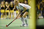 Berlin, Germany, January 31: Dinah Grote #9 of HTC Uhlenhorst Muehlheim before scoring the winning penalty during the 1. Bundesliga Damen Hallensaison 2014/15 semi-final hockey match between HTC Uhlenhorst Muehlheim (white/green) and Harvestehuder THC (black/yellow) on January 31, 2015 at the Final Four tournament at Max-Schmeling-Halle in Berlin, Germany. Final score 6-5 after penalties (3-1, 3-3, 3-3, 3-3). (Photo by Dirk Markgraf / www.265-images.com) *** Local caption ***