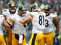 Ben Roethlisberger #7 of the Pittsburgh Steelers celebrates the two-point conversion following a touchdown with teammate Jesse James #81 of the Pittsburgh Steelers in the second quarter against the Seattle Seahawks during the game at CenturyLink Field on November 29, 2015 in Seattle, Washington. (Photo by Jared Wickerham/DKPittsburghSports)