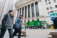 Waste Management (WM) vehicles are parked in front of the New York Stock Exchange on Friday, April 21, 2017 as WM  rings the closing bell in celebration of Earth Day. (© Richard B. Levine)