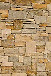 Dry fit stone masonry wall close up