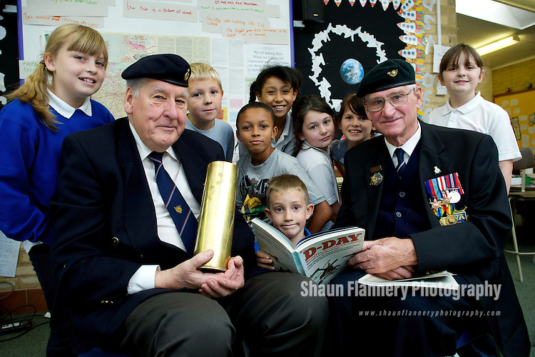 Pix: Shaun Flannery/shaunflanneryphotography.com...COPYRIGHT PICTURE>>SHAUN FLANNERY>01302-570814>>07778315553>>..30th September 2010..........Sheffield war veterans visit Concord Junior School to 'Keep the Memories Alive'.The World War 2 'heroes' gave a talk to year 4 &5 pupils about their experiences during the war..Veterans Don Gillott (left) and Pat Strafford with pupils L-R Megan Wakefield, Oliver Blakemore, Jaiden Lee, Bradley Sheldon, Lia Moore, Francesca Winter, Megan Godbehere, Alexander Bingham,