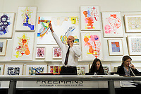 Buyers' representatives Colin Clarke works the phone lines as the bidding for the Lehman Brothers/Neuberger corporate collection at Freeman's Gallery opens Sunday, Nov. 7, 2010 in Philadelphia, Pa. The auction was the third round of the Lehman Brothers corporate artworks to be sold at Freeman's. (Bradley C Bower/Bloomberg News)