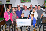 Cheque Presentation: Nollaig McCarthy presenting a checque for €5940.00, the proceeds of a Shave & Dye event held in McCarth'ys Bar, Finuge recently  to Kay Hanley, Chairperson Listowel Hospice at Mcacrthy's Bar on Friday night last.  Front : Catriona & Mary & Nollaig McCa\rthy & Kay Hanley. Back : Denis O'Donoghue, Dan Lyons, Donal Browne, Liam Kelly, Noah Enright, DJ Kelly, Eillen Sheehy, John McKenna, Julie Gleeson, Shane Moran & John Walsh.