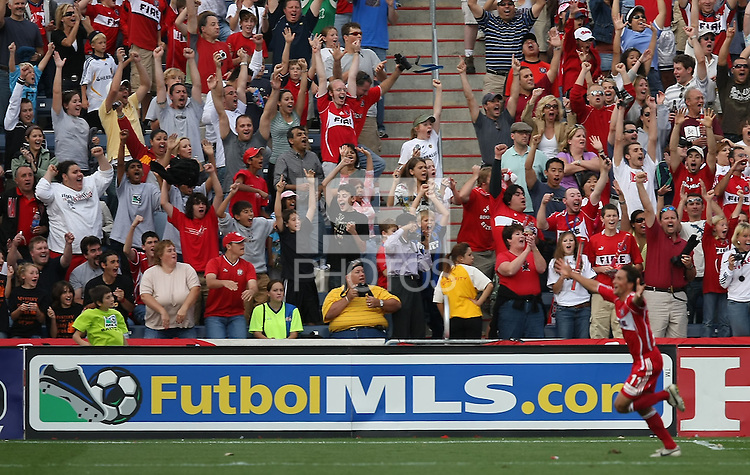 Chicago Fire fans react after Fire midfielder John Thorrington scored the game-winning goal in the 93rd minute. The Chicago Fire defeated the Los Angeles Galaxy 1-0 to secure a spot in the MLS playoffs at Toyota Park in Bridgeview, IL., on October 21, 2007.