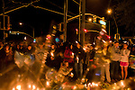 People gather for a candlelight vigil outside of Rep. Gabrielle Giffords office on the evening following her shooting at an unincorporated Pima County.Safeway store.  Giffords survived the attack, even though the shooter's bullet passed through her head.  She is expected to recover.  Along with Giffords, there were[Number] of victims who survived the attack and six who were killed....  Scenes from Tucson, Arizona in the days following a mass shooting that left six dead and [number] injured.  The shooter, identified as Jared Loughner, was captured at the scene and charged in federal court on January 9th, 2011.  Among the injured was democratic congresswoman Gabrielle Giffords.  The dead included a federal judge, a nine year-old girl, and several septaugenarians who had all come to see the congresswoman at one of her 'Congress on the Corner' events.
