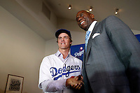Zack Greinke is introduced as the newest member of the Los Angeles Dodgers by Dodgers co owner Magic Johnson during a press conference at Dodger Stadium in Los Angeles, California on December 11, 2012. (Larry Goren/Four Seam Images)