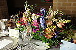 Flowers on the tables at the Recipe for Success' Delicious Alchemy Dinner at the home of Becca Cason Thrash Wednesday April 19,2017.(Dave Rossman Photo)
