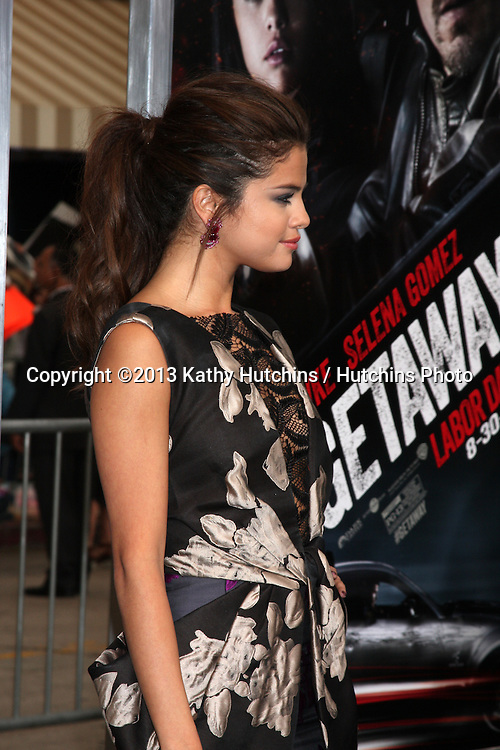 "LOS ANGELES - AUG 26:  Selena Gomez at the ""Getaway"" Premiere at the Village Theater on August 26, 2013 in Westwood, CA"