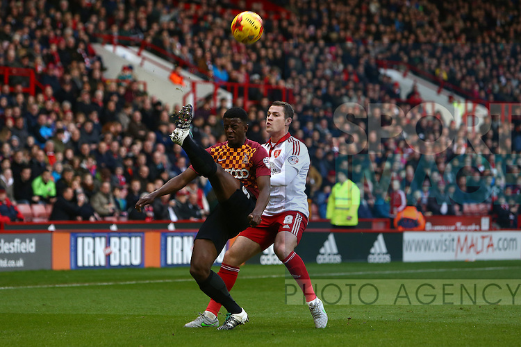 Sheffield United's Paul Coutts pressures Greg Leigh of Bradford - Sheffield United vs Bradford City - Skybet League One - Bramall Lane - Sheffield - 28/12/2015 Pic Philip Oldham/SportImage