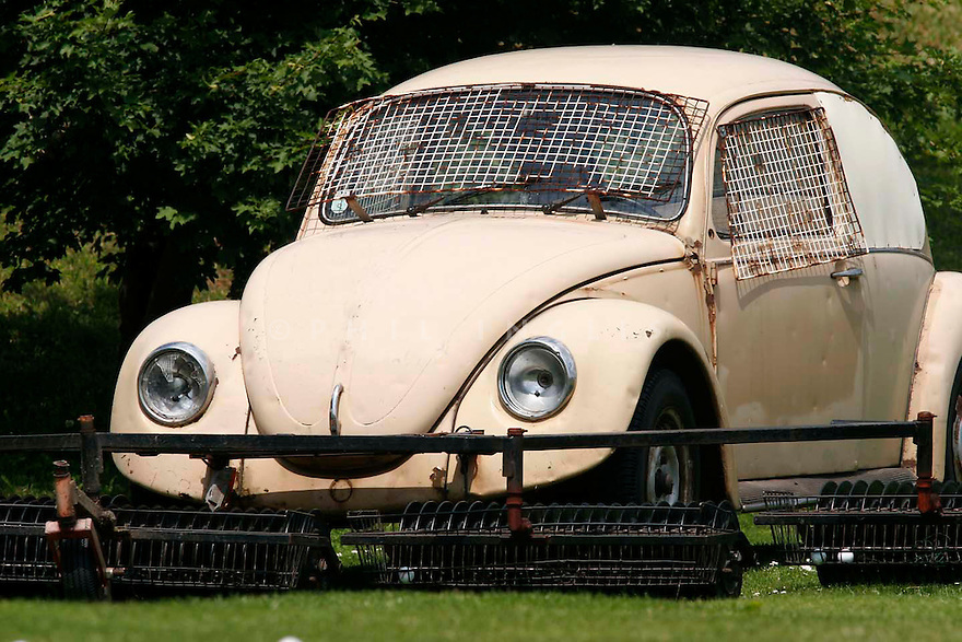 A beaten up VW beetle used for ball retrieving at a club in Vienna, Austria