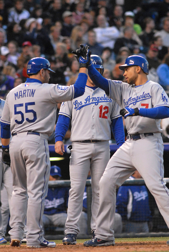 Los Angeles Dodgers players Russell Martin (55), Jeff Kent (12) celebrate a 3-run home run by James Loney (7) during the Dodgers 12-7 win over the Colorado Rockies in Denver, Colorado on May 3. FOR EDITORIAL USE ONLY