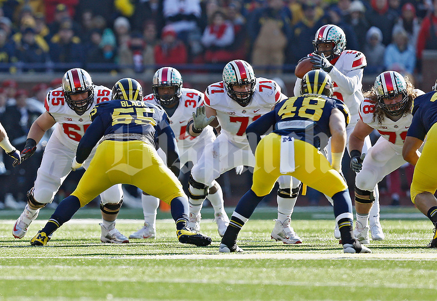 Ohio State Buckeyes offensive linesman Pat Elflein (65), Ohio State Buckeyes offensive linesman Corey Linsley (71) and Ohio State Buckeyes offensive linesman Andrew Norwell (78) against Michigan Wolverines during their college football game at Michigan Stadium in Ann Arbor, Michigan on November 30, 2013.  (Dispatch photo by Kyle Robertson)