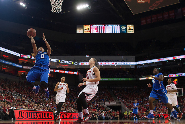 Guard Jennifer O'Neill of the Kentucky Wildcats shoots during the women's basketball game against the Louisville Cardinals at KFC Yum Center on Sunday, December 7, 2014 in Louisville, Ky. Kentucky defeated Louisville for the fourth straight year, 77-68. Photo by Michael Reaves | Staff