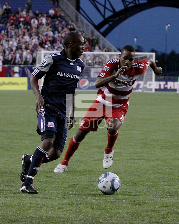 New England Revolution forward Kheli Dube (11) dribbles the ball as FC Dallas midfielder/forward Atiba Harris (16) moves to tackle.  The New England Revolution drew FC Dallas 1-1, at Gillette Stadium on May 1, 2010