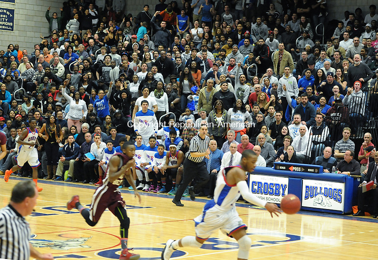 WATERBURY, CT-4 February 2014-020414EC08-   Crosby's fans cheer for Tyshon Rogers as he charges down the court against Sacred Heart Tuesday night. The Hearts defeated the Bulldogs, 90-82 in the sold out game. Erin Covey Republican-American