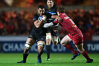 Taulupe Faletau of Bath Rugby looks to fend Rhys Patchell of the Scarlets. European Rugby Champions Cup match, between the Scarlets and Bath Rugby on October 20, 2017 at Parc y Scarlets in Llanelli, Wales. Photo by: Patrick Khachfe / Onside Images