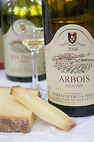 bottle and glass of arbois savagnin wine and comte cheese domaine de la pinte arbois france