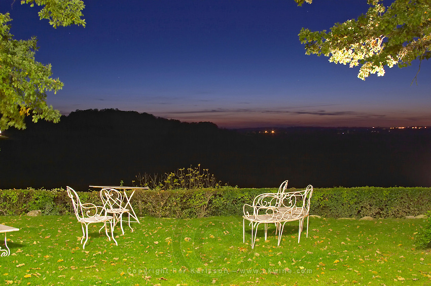 Chateau Belingard garden with garden furniture at night, the vineyard in the background Chateau Belingard Bergerac Dordogne France