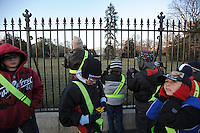 Tourists from Florida take pictures in front of the White House as hundreds of thousands are expected in the capitol ahead of Barack Obama's inauguration as the 44th U.S. President in Washington DC on January 16, 2009.