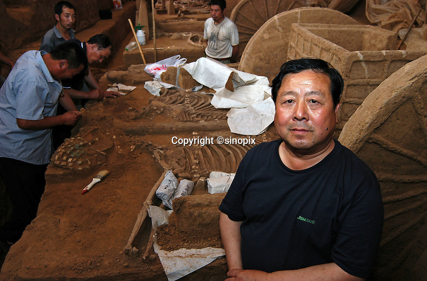 Liu Zhong Fu, from the archaeology division of  Chinese Academy of Social Sciences, he is the senior researcher and site manager of the ancient Chinese chariots dating back to the Sang Dynasty (3300 years ago) are uncovered in Anyang, Henan Province. The chariots are the oldest and best preserved ever discovered. The chariots were buried with their horses and grooms who were sacrificed at burial...PHOTO BY HE SHI / SINOPIX