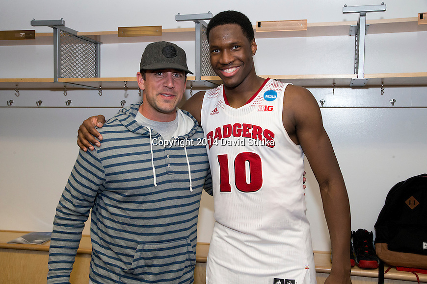 Wisconsin Badgers Nigel Hayes (10) poses with Green Bay Packers quarterback Aaron Rodgers after  a regional semifinal NCAA college basketball tournament game against the Baylor Bears Thursday, March 27, 2014 in Anaheim, California. The Badgers won 69-52. (Photo by David Stluka)