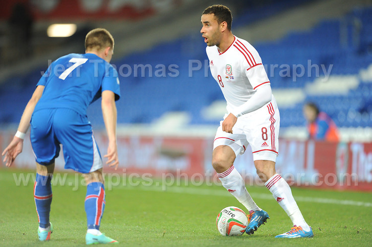 Hal Robson-Kanu of Wales looks looks to get past Johann Berg Guomundsson of Iceland. Cardiff City Stadium, Cardiff, Wales, Wednesday 5th March 2014. The Football Association of Wales - Vauxhall International Friendly - Wales v Iceland. Pictures by Jeff Thomas Photography - www.jaypics.photoshelter.com - Contact: thomastwotimes@live.co.uk - 07837 386244