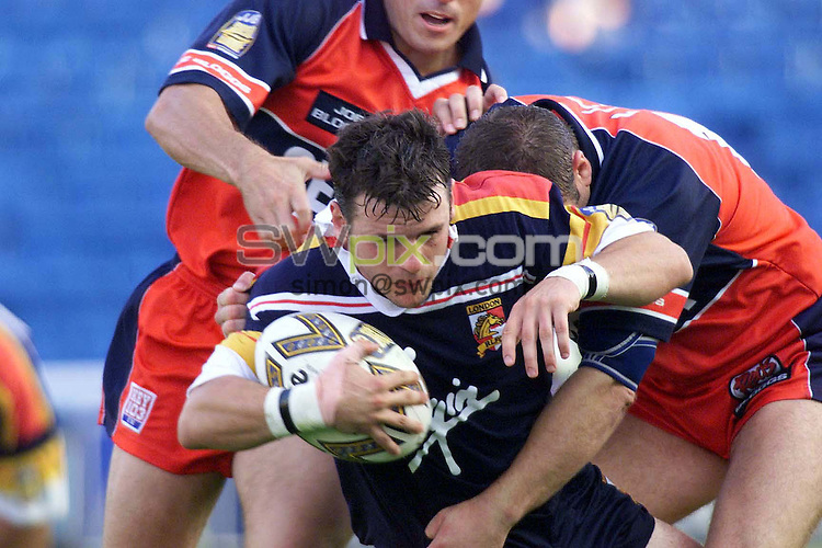 PIX...Simon Wilkinson...London Broncos v Salford City Reds, 7/08/99..COPYWRIGHT PICTURE>>SIMON WILKINSON>>01943 436649>>..London winger Rob Smyth is brought down the chasing Salford defence on his way to the try line.