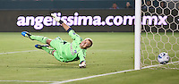 CARSON, CA – June 18, 2011: FC Dallas goalie Kevin Hartman (1) attempts to save Michael Lahoud's goal shot during the match between Chivas USA and FC Dallas at the Home Depot Center in Carson, California. Final score Chivas USA 1, FC Dallas 2.