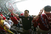 United States Men's National team fan Brent Gamit leads some cheers before the start of the game at Azteca stadium. The United States Men's National Team played Mexico in a CONCACAF World Cup Qualifier match at Azteca Stadium in, Mexico City, Mexico on Wednesday, August 12, 2009.