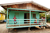 BELIZE, Hopkins, kids on the balcony of their home in Hopkins